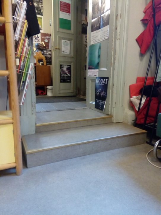 The Book café's stairs after the entrance